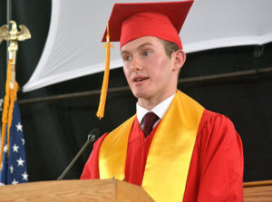 Valedictorian Sean Morton discusses with classmates the concept of home. Photo/Ed Karvoski Jr.