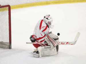 Hudson goalie Adam Devlin positions his body in front of a shot.