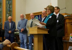 State Rep. Kate Hogan presents a resolution on behalf of her and State Sen. Jamie Eldridge to Richard Harrity, president of the Hudson Historical Society, and Hudson Board of Selectmen (l to r) John Parent, James Quinn, Scott Duplisea, and Fred Lucy. Photo/Josh Blood