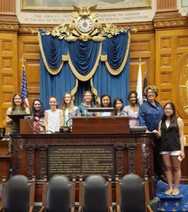 Rep. Kate Hogan with the artists in the House Chamber (Photo/submitted)