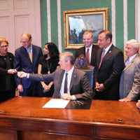 Governor Charlie Baker signs the legislation at the State House. Photo/submitted