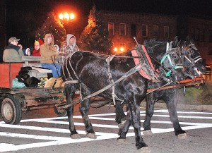 Stroll guests travel past the Wood Square rotary via a horse-drawn hayride.