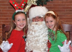 The Nelson sisters – Emma, 9, and Rylie, 7 – meet Santa Claus.
