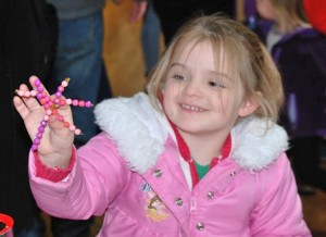 Audrey Giusti, 5, displays the snowflake craft she created at Serendipity.