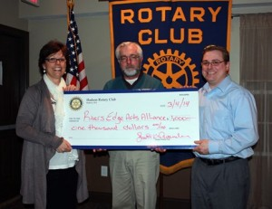 (l to r) Lynne Johnson, executive director of the River's Edge Arts Alliance, receives a donation from Rotarian Lawrence Norris and Hudson Rotary President Jeff Hoisington. (Photo/submitted)