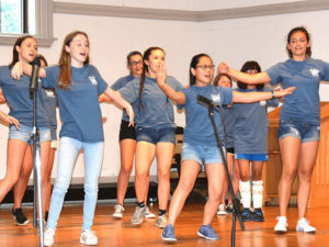 "Youth Theater performers present a number from ""Once on This Island."" Photo/Ed Karvoski Jr."