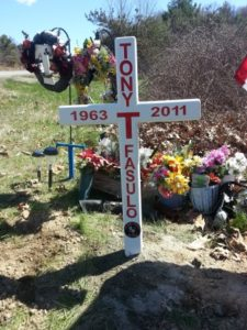 """A cross memorializes Tony """"T"""" Fasulo on Route 290 in Shrewsbury."""