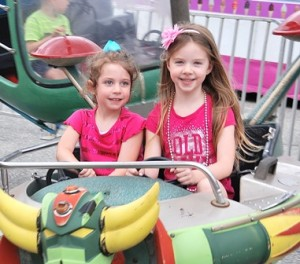 At the wheels of the Mini-Enterprise are the Miller sisters: Brooke, 4, and Olivia, 5.