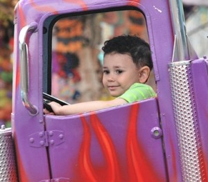 First-time driver Daniel Oliveira, 3, keeps on trucking.