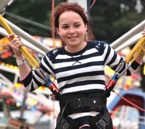 Tianna Leone, 11, jumps on the Euro Bungee.