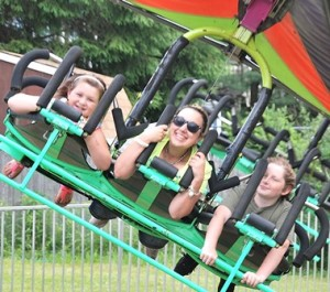 Riding the Cliff Hanger are (l to r) Izabella Juliano, 7, Nicole DeAngelis and Justin Frenzy, 10.
