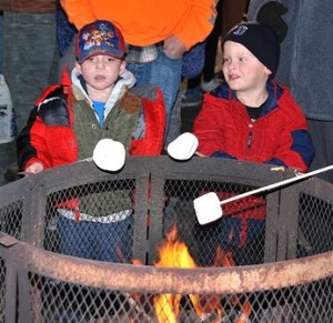 Travis MacNeill, 4, and Seth Peltier, 3, try their hands at roasting marshmallows.