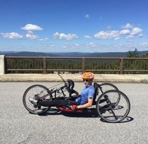 Owen Anketell rests in his handcycle on a bridge in New Hampshire. Photo/submitted