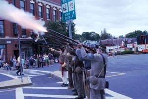 Members of the 12th Georgia Regiment fire off muskets near the Hudson Rotary. Photo/Dakota Antelman