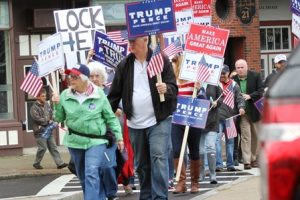 Trump supporters cross Main Street near the Hudson Rotary during the protest.