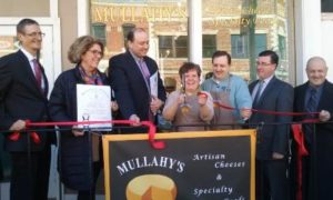 Gathered at the ceremonial ribbon cutting of Mullahy's earlier this year are (l to r) Selectmen Board Chair Fred Lucy; state Rep. Kate Hogan, D-Stow; state Sen. Jamie Eldridge, D-Acton; Katie Quinn, owner, with her husband Tom; Jim McGowan, Assabet Valley Chamber of Commerce board chair; and Selectman Jim Quinn. Photo/submitted
