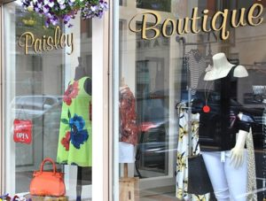 Paisley Boutique displays items to attract window shoppers.