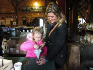 Michelle Kirkpatrick with daughter Julia, 5, creates an ornament at Armeno Coffee Roasters.