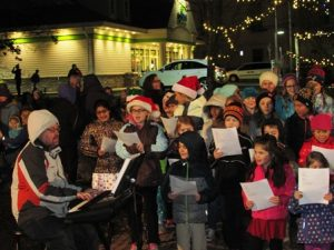 Marion E. Zeh School's chorus leads the crowd in holiday songs at the tree lighting ceremony.