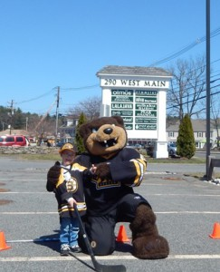 """Liam playing hockey with Boston Bruins mascot """"Blades"""""""