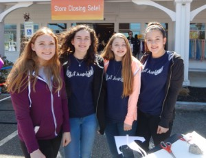 Event volunteers (left to right): Maggie Tobin, Anna Clune, Hailey Bardellini and Ana Laura Carvalho from the Saint Bernadetts community outreach group, Lil' Angels
