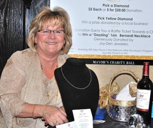 Donna Barberio displays a Bernardi necklace donated by Joy-Den Jewelers, the grand prize of a raffle. Jen Lynch won the necklace.