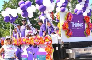 Participants of Thrive, Support & Advocacy ride on its float. Photos/Ed Karvoski Jr.