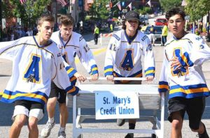The team sponsored by St. Mary's Credit Unit – consisting of Assabet Valley Regional Technical High School hockey players – places second in the Bed Race. Photos/Ed Karvoski Jr.