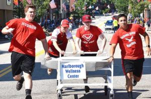 Winning the Bed Race is the team sponsored by Marlborough Wellness Center, consisting of Hudson High School hockey players (l to r) Cam O'Brien, Nicholas Werner, Jameson Felteau and Bryce Miranda.