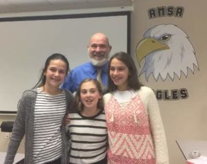 Gathered with their teacher Mark Vital are sixth-graders (l to r) Megan Wagher, Isabel Steinberg and Julia Silva at Advanced Math and Science Academy.