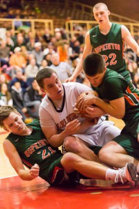 Marlborough's Liam Shanahan wrestles for the ball with a Hopkinton player.