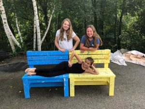 Mackenzie Brennen (l) and Cassie Fiore with Emily Roca (laying on the bench) display one of their Buddy Bunches. Photos/submitted