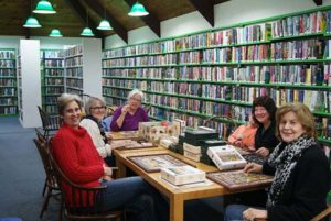 Marta Burbeck (far left) with members of the Puzzle Club at Stow Library Photo/submitted