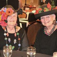 "Bette Medine and Joan Ledoux wear Kentucky Derby style hats for the ""Fiesta at the Inn"" themed Mayor's Charity Ball. Photos/Ed Karvoski Jr."