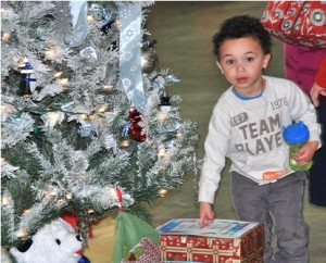 Bryce Barnes, 3, places a raffle ticket for a chance to win a tree he likes.