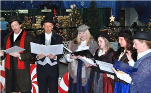 Costumed in the Charles Dickens era, members of Ghost Light Players perform carols.