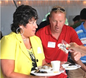 Marlborough City Clerk Lisa Thomas and Brian Chapman are served clam chowder.