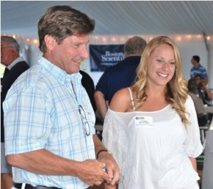 Mingling before dinner are Darren McLaughlin, general manager of Wayside Racquet and Swim Club, and his daughter, Kate.