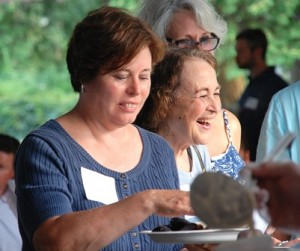 Jill Capuano and her mother, Carol Ward, are served clam chowder.