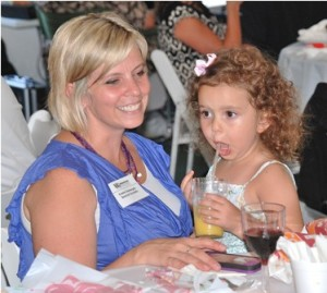 Kristin Santangelo of Boston Scientific spends time with her daughter, Kora, 3, the youngest party guest.