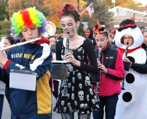 Costumed members of the Whitcomb Middle School Marching Band provide music for the festivities.