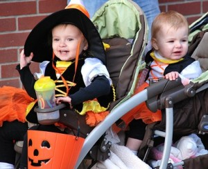 Cruising in a stroller dressed as candy corn characters are the Wells sisters: Shannon, 2, and Natalie, 1.