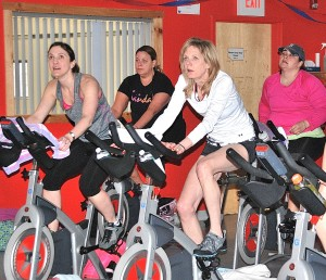 Stationary bicyclists participate in the 10th annual Pedal to End Cancer, held March 2 at Wayside Racquet & Swim Club. (Photo/Ed Karvoski Jr.)