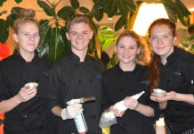 Assabet Valley Regional Technical High School culinary arts students (l to r) Peyton Corriveau, Zachary Calanan, Marisa Jewett and Brianna Welch prepare and serve pumpkin crème brulee. Photos/Ed Karvoski Jr.