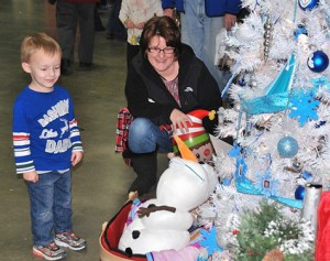 """A tree decorated based on the film """"Frozen"""" gets the attention of Kenneth Durkin, 3, and his mother Anne Hubert."""