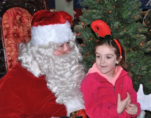 Kaleigh Bauks, 6, shares her gift requests with Santa.