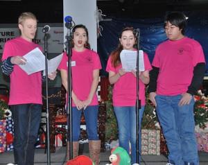 Marlborough High School Tri-M Music Honor Society students perform carols.
