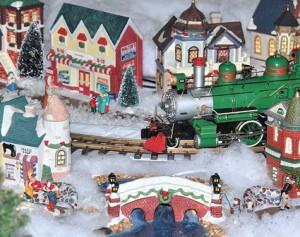 A train travels through the miniature Victorian Village.