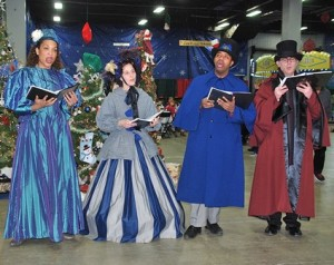 Olde Towne Carolers sing holiday music at last year's Metrowest Festival of Trees. File photo/Ed Karvoski Jr.