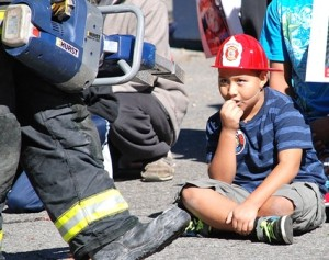 Auner Calderon, 9, gets a close-up look at the Jaws of Life during a demonstration.